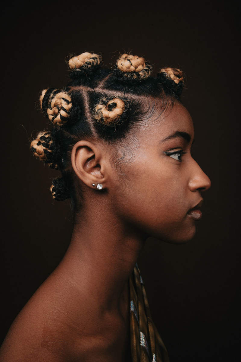 Collection of images showcasing an African-Canadian models hairstyles and clothing